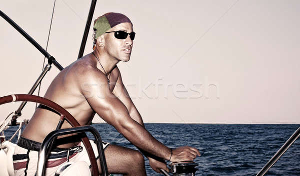 Handsome man on sail boat Stock photo © Anna_Om