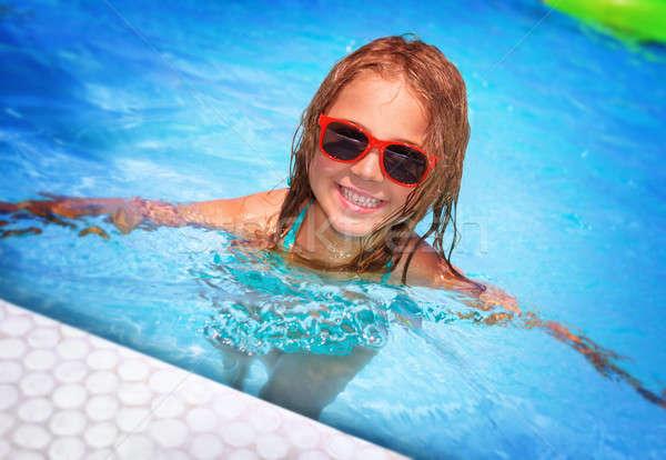 Happy girl in swimming pool Stock photo © Anna_Om