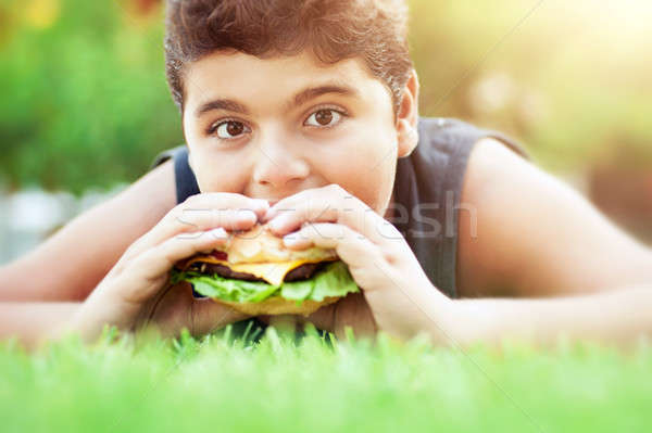 Teen boy eating burger Stock photo © Anna_Om