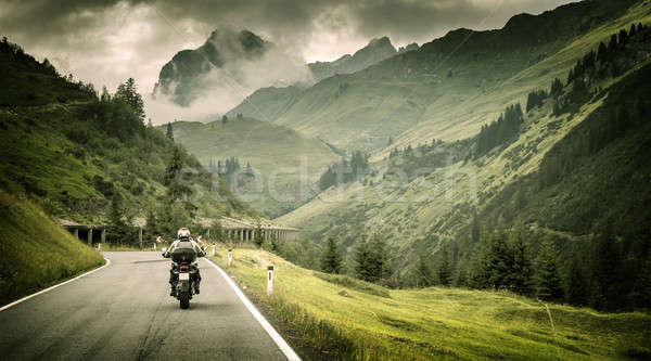 Motorcyclist on mountainous highway Stock photo © Anna_Om