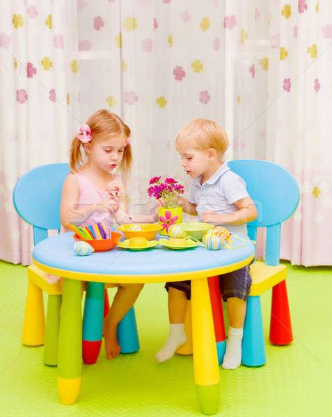 Stock photo: Little kids painting Easter eggs