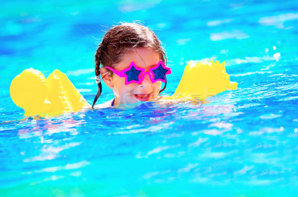 Cute little baby swiming in the pool Stock photo © Anna_Om