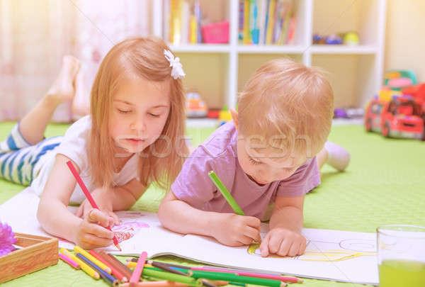 Happy baby boy & girl enjoying homework Stock photo © Anna_Om