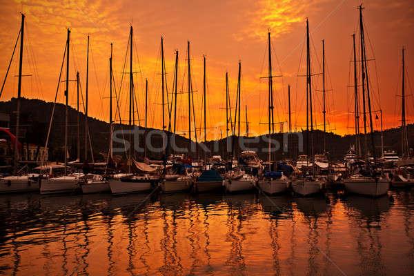 Jacht kikötő narancs naplemente csetepaté luxus Stock fotó © Anna_Om
