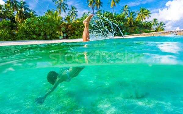 Mujer natación subacuático buceo turquesa transparente Foto stock © Anna_Om