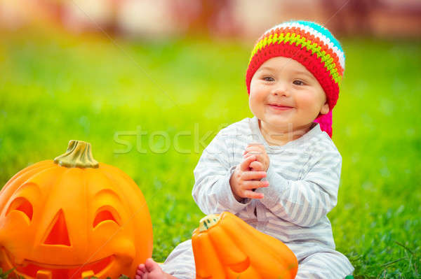 Cute baby playing with pumpkins Stock photo © Anna_Om