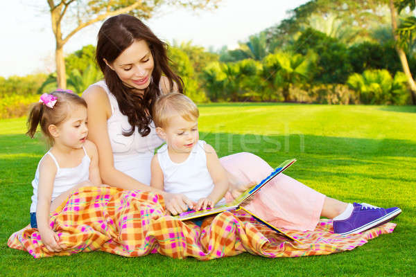 Mother with children read book Stock photo © Anna_Om
