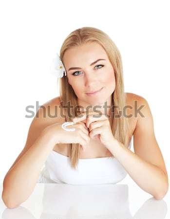 Cute female applying facial cream Stock photo © Anna_Om