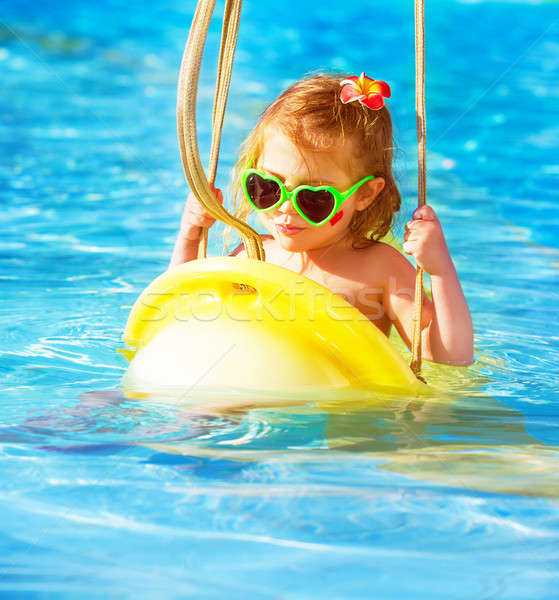 Baby girl swinging on water attractions Stock photo © Anna_Om