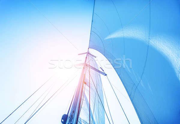 Sail on blue sky background Stock photo © Anna_Om