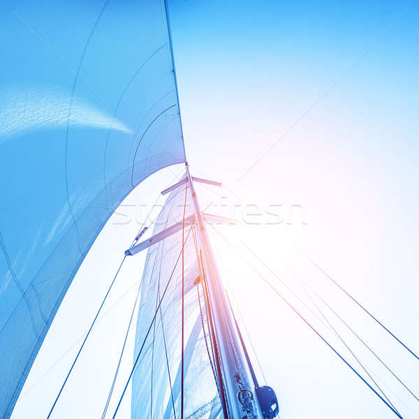 Sail on blue sky backdrop Stock photo © Anna_Om