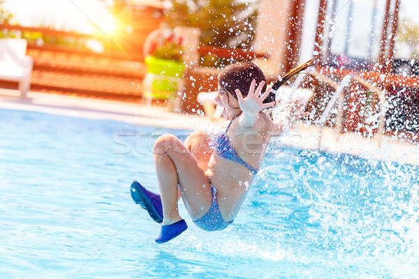Stock photo: Joyful girl in the pool
