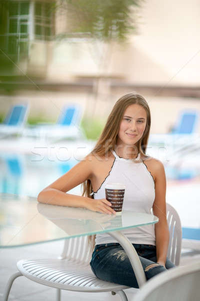 Cute girl having coffee in outdoors cafe Stock photo © Anna_Om
