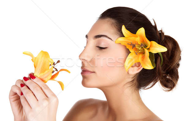Woman smelling lily flower Stock photo © Anna_Om
