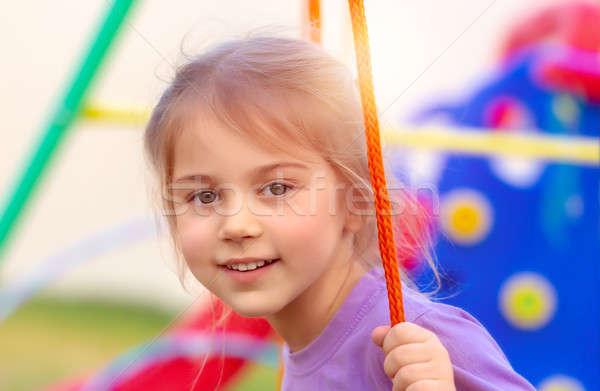 Dziewczynka huśtawka portret cute boisko Zdjęcia stock © Anna_Om