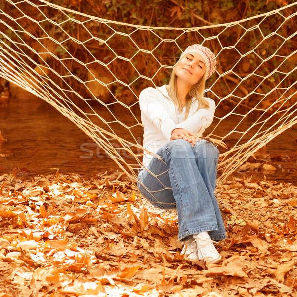 Aranyos női ül függőágy kép csukott szemmel Stock fotó © Anna_Om