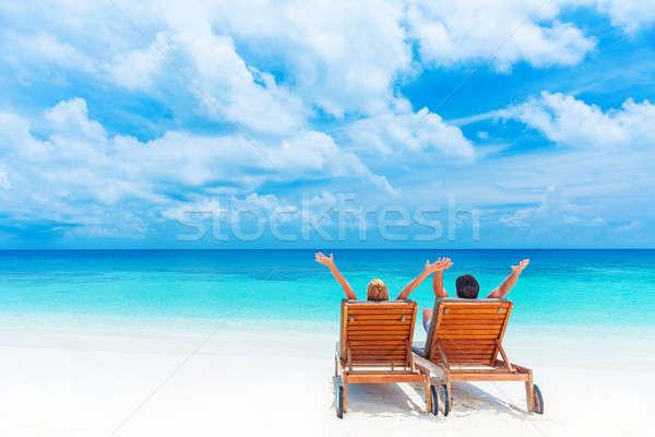 Plaj iki mutlu insanlar rahatlatıcı oturma Stok fotoğraf © Anna_Om