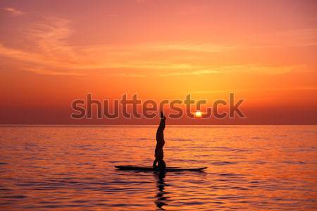 Yoga Ausbilder Strand Silhouette Balancing Wasser Stock foto © Anna_Om