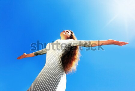 Beautiful female over blue clean sky Stock photo © Anna_Om