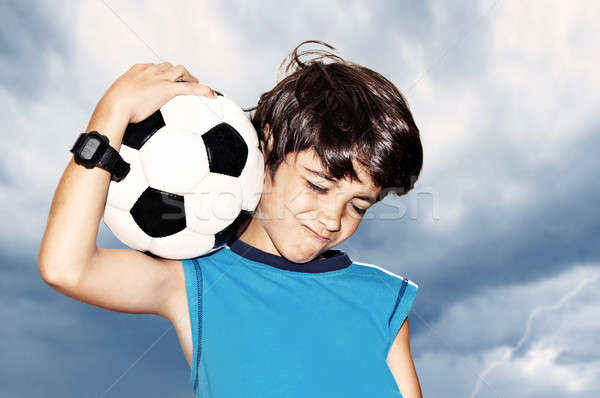 Voetballer vieren overwinning vieren cute jongen Stockfoto © Anna_Om