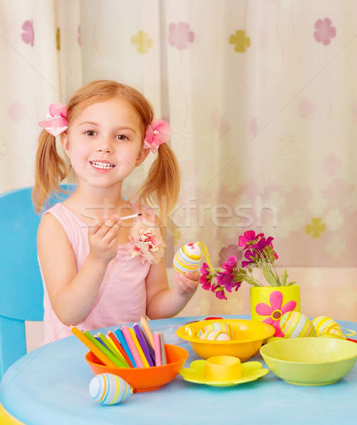 Little girl paint Easter eggs Stock photo © Anna_Om