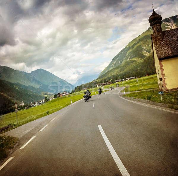 Biker race across mountainous village Stock photo © Anna_Om
