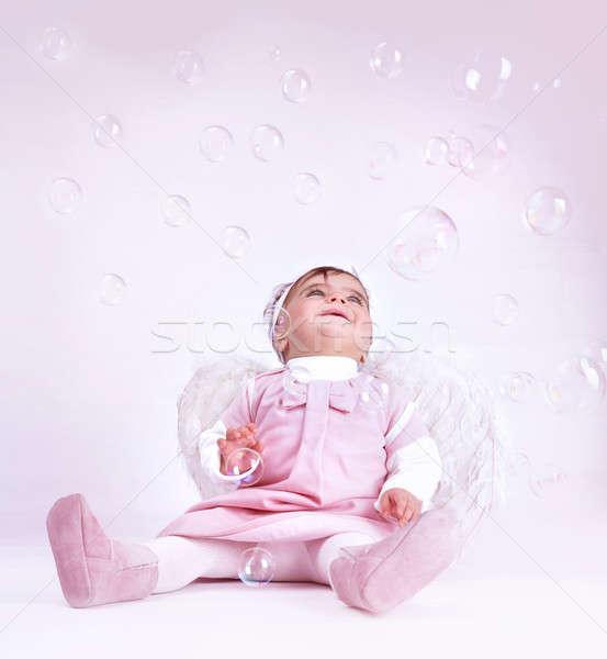 Stock fotó: édes · kicsi · angyal · ül · stúdió · játszik