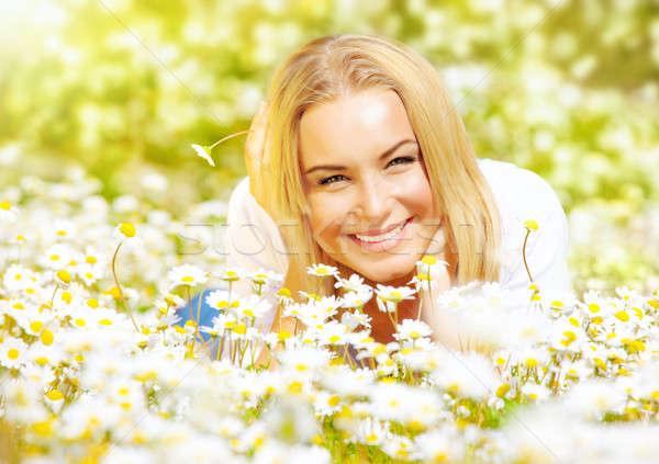 Girl on chamomile glade Stock photo © Anna_Om