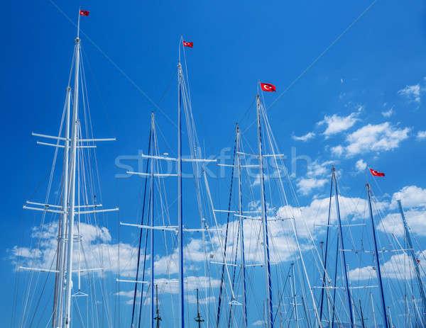 Stock fotó: Török · jacht · kikötő · zászlók · kék · ég · vitorlázik