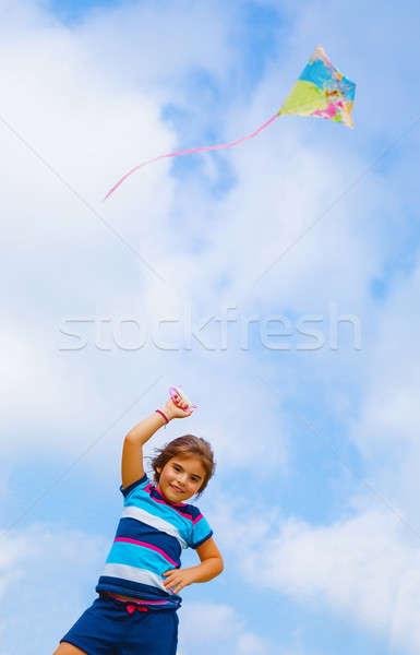 Menina jogar pipa adorável colorido ao ar livre Foto stock © Anna_Om