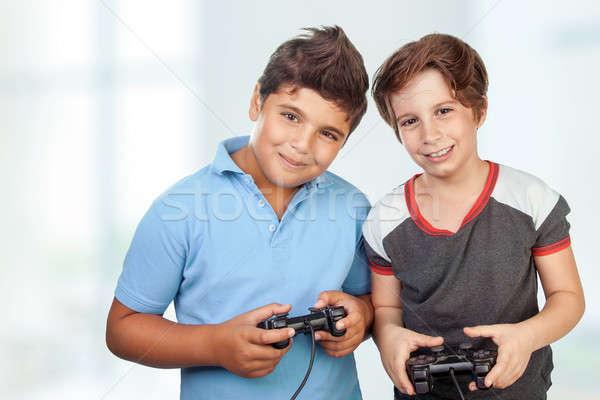 Gelukkig jongens spelen video games portret twee Stockfoto © Anna_Om