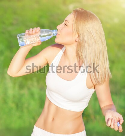 Healthy woman drinks water Stock photo © Anna_Om