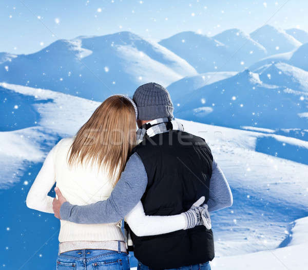 Stock photo: Happy couple hugging outdoor at winter mountains, rear view