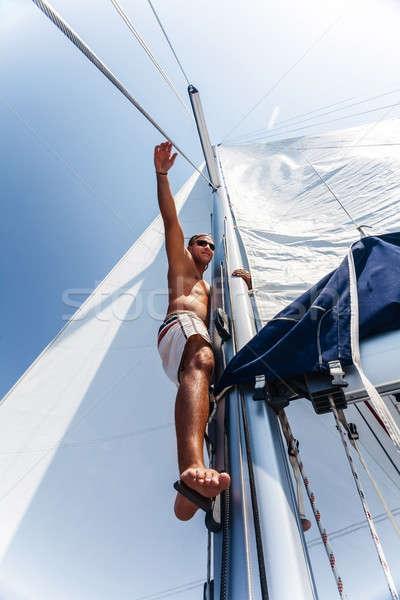 Stock photo: Cute sailor fix sail