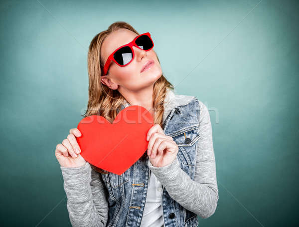 Stock photo: Cute girl with red heart
