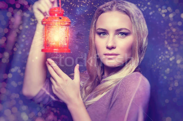 Beautiful woman with glowing lantern Stock photo © Anna_Om