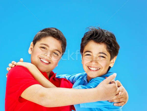 Happy cute boys over blue sky Stock photo © Anna_Om