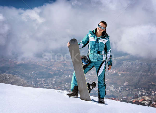 Snowboard mujer pie superior montana snowboard Foto stock © Anna_Om