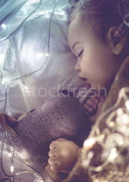 Bonitinho pequeno bebê adormecido casa cama Foto stock © Anna_Om