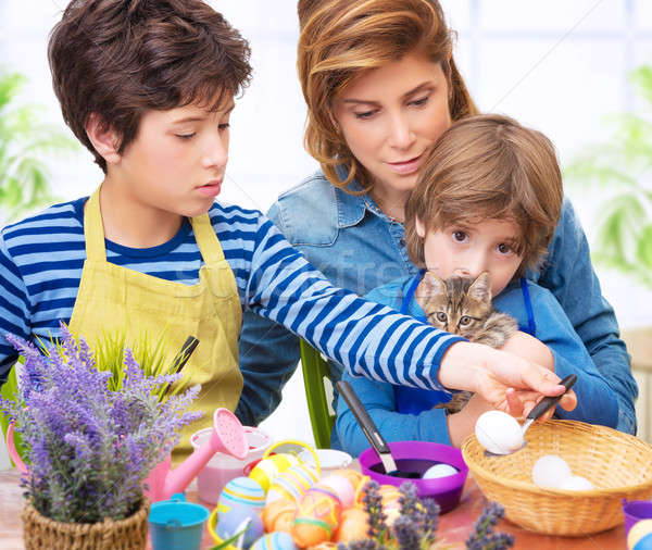 Stock photo: Happy family paint Easter eggs