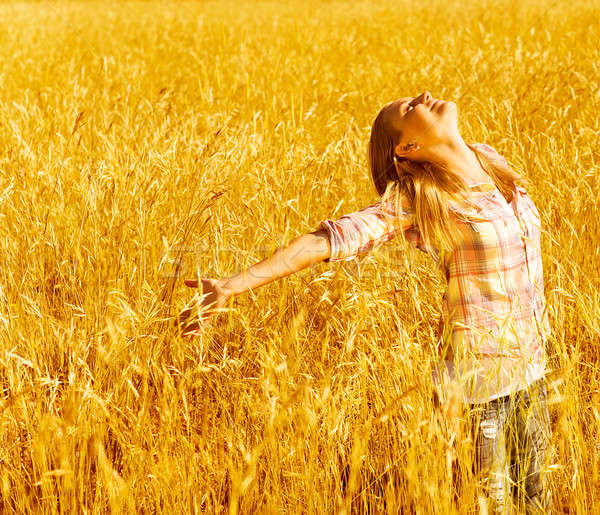 Happy woman on wheat field Stock photo © Anna_Om