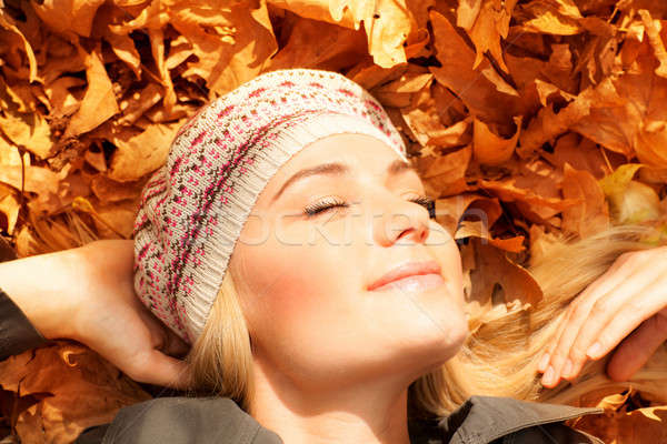 Cute girl dreaming on autumn leaves Stock photo © Anna_Om