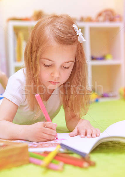 Preschooler girl painting in daycare Stock photo © Anna_Om