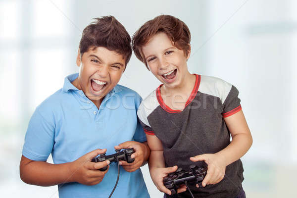 Best friends playing on playstation Stock photo © Anna_Om