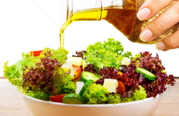 Fraîches salade huile d'olive isolé blanche Photo stock © Anna_Om