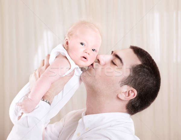 Handsome daddy kissing daughter Stock photo © Anna_Om
