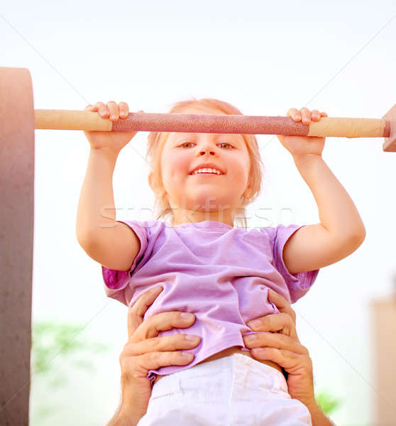 Little girl on crossbar Stock photo © Anna_Om