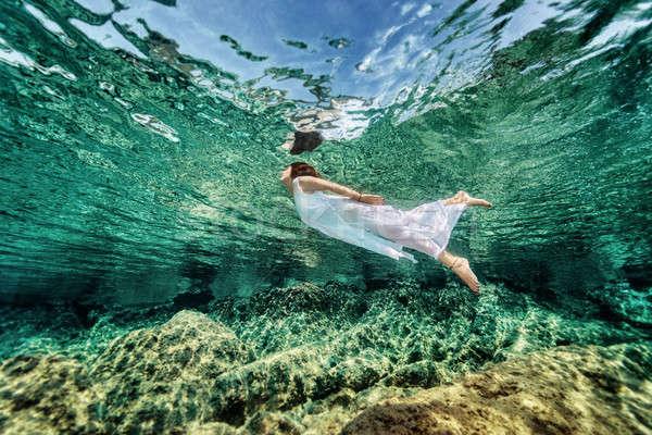 Swimming in transparent sea Stock photo © Anna_Om