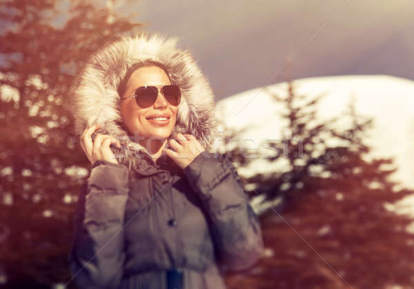 Beautiful woman in winter park Stock photo © Anna_Om