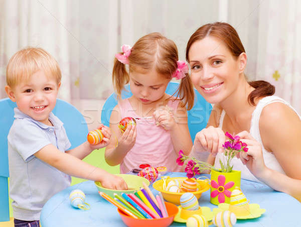 Stock photo: Young family paint Easter eggs